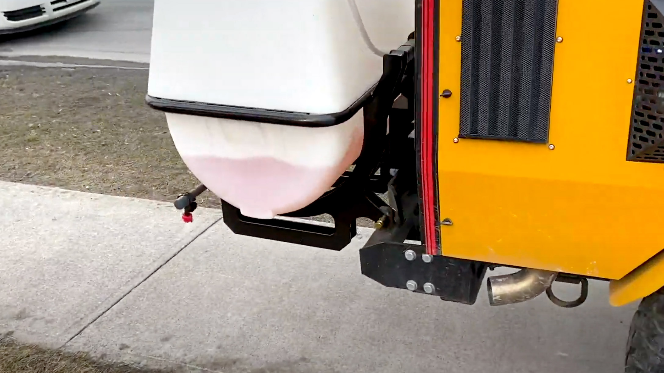 trackless vehicles brine sprayer attachment