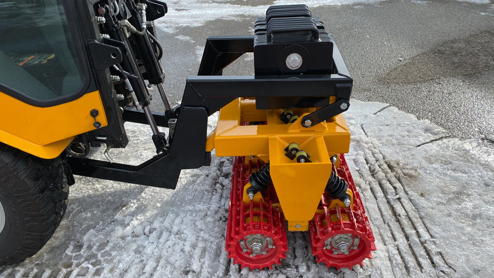 trackless vehicles snow lion ice-breaker attachment close-up side view