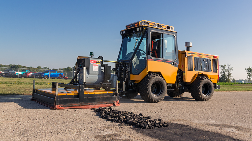 trackless vehicles infrared asphalt heater attachment on sidewalk tractor working in parking lot