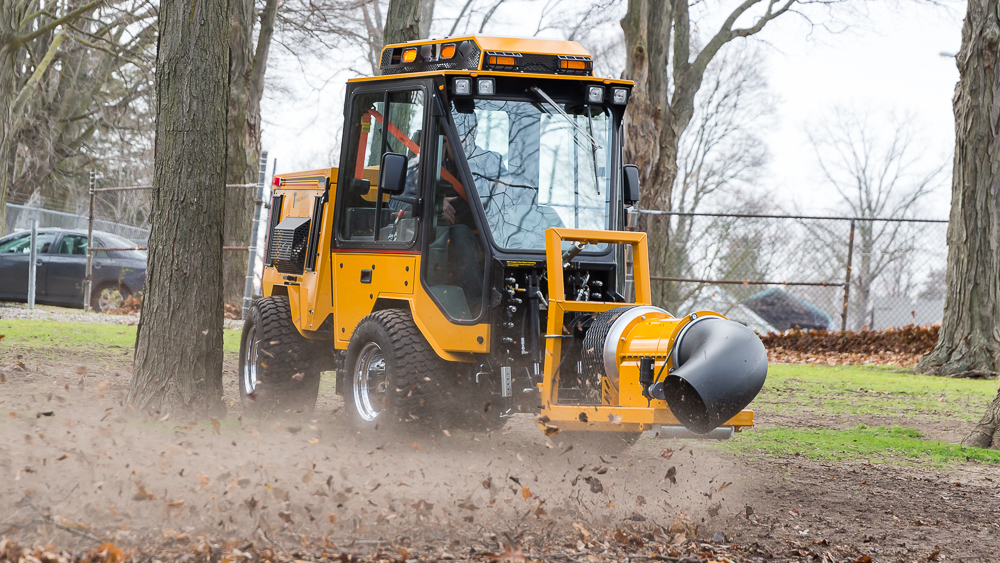 trackless vehicles buffalo turbine debris blower attachment on sidewalk municipal tractor blowing leaves side front view