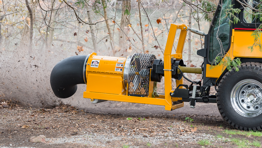 trackless vehicles buffalo turbine debris blower attachment on sidewalk municipal tractor blowing leaves side view close-up