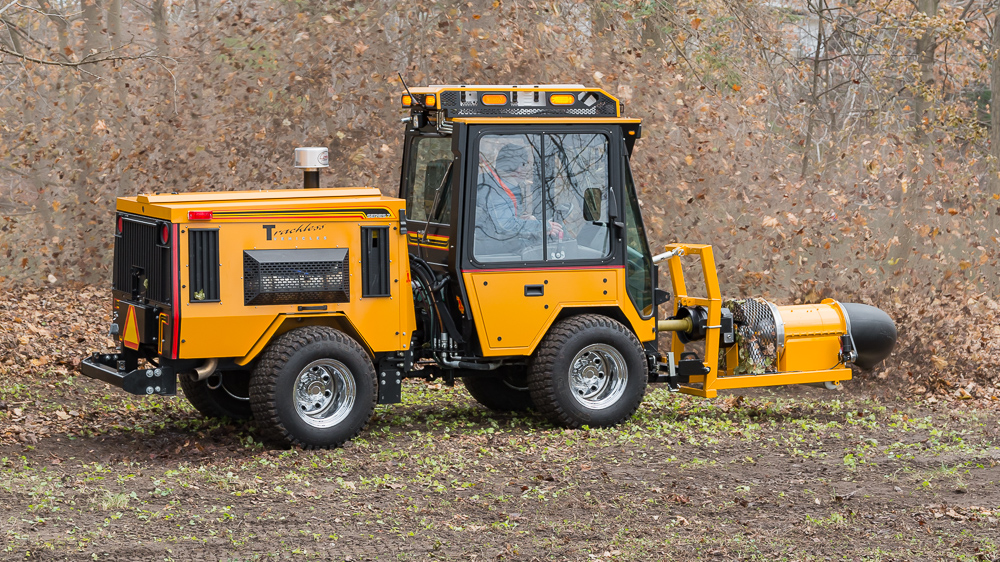 trackless vehicles buffalo turbine debris blower attachment on sidewalk municipal tractor blowing leaves side view