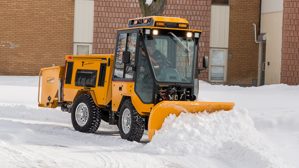 trackless vehicles double trip plow attachment on sidewalk tractor in snow