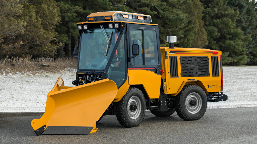 trackless vehicles fixed wing v-plow attachment on sidewalk tractor side view