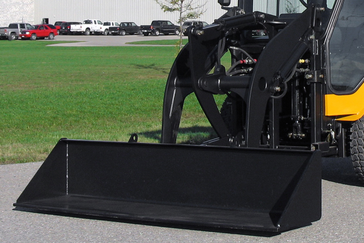 trackless vehicles front end loader attachment on sidewalk municipal tractor close-up front view