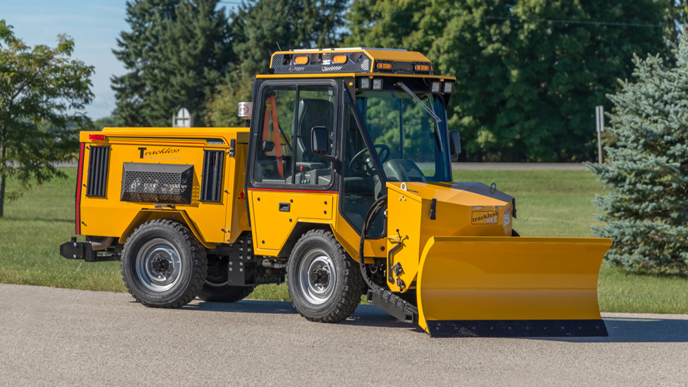 trackless vehicles front-mount spreader and plow attachment on sidewalk tractor side view