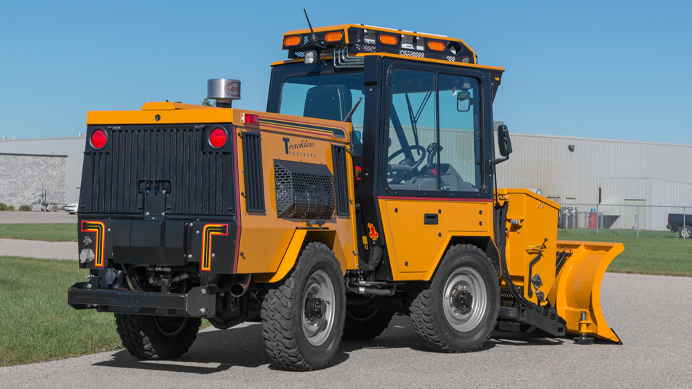 trackless vehicles front-mount spreader and plow attachment on sidewalk tractor in snow side rear view
