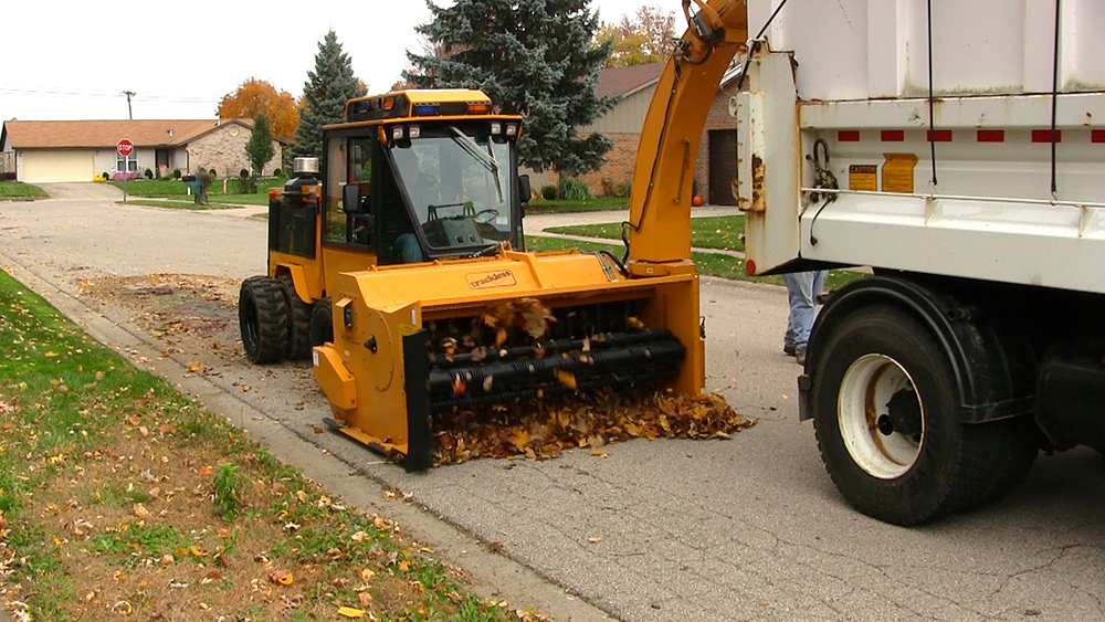snow on ground after trackless vehicles 5-position folding v-plow attachment on sidewalk tractor