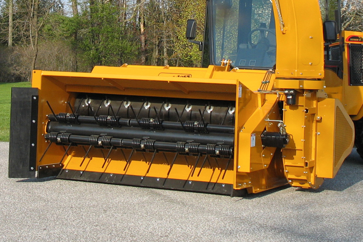 trackless vehicles leaf loader attachment on sidewalk municipal tractor close-up front view