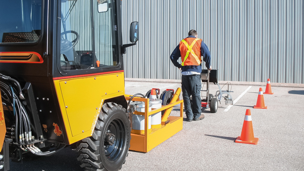 trackless vehicles line and stencil painter attachment on sidewalk tractor