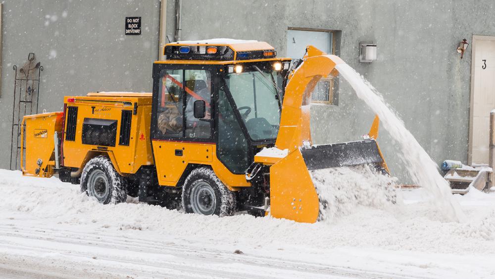 trackless vehicles ribbon snowblower attachment on sidewalk tractor in snow on sidewalk