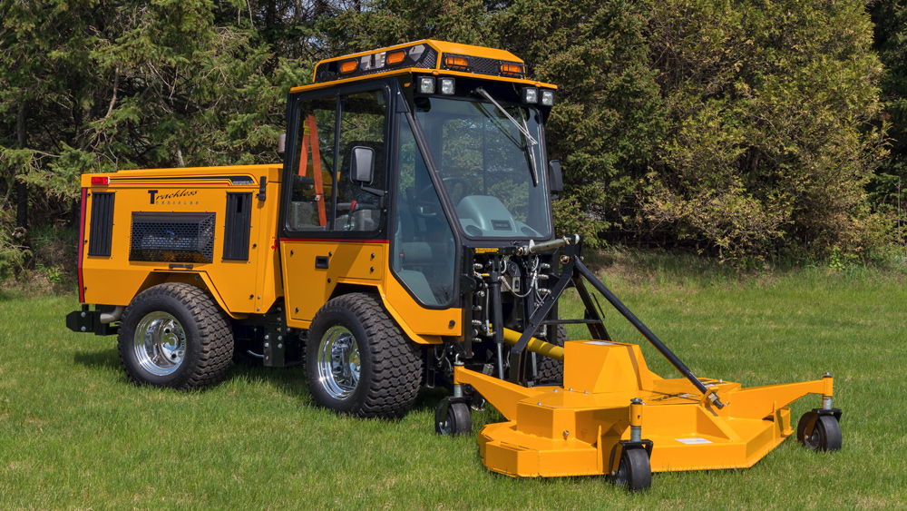 trackless vehicles rotary finishing mower 6' attachment on sidewalk municipal tractor front side view