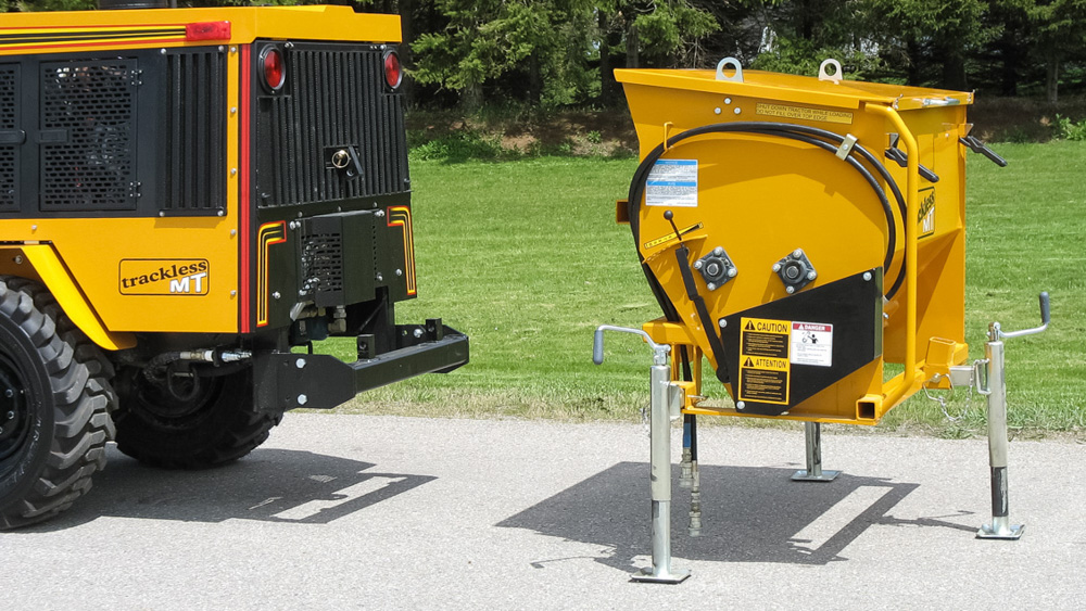 trackless vehicles rear-mount sidewalk spreader attachment close-up side view