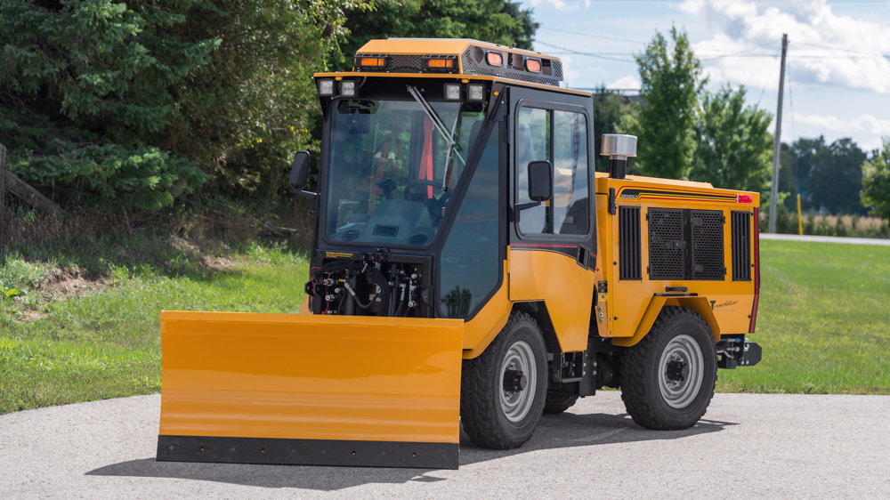 trackless vehicles angle snowplow attachment on sidewalk tractor front view