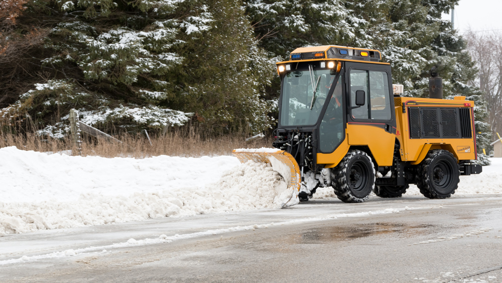 trackless vehicles angle snowplow attachment on sidewalk tractor in snow side view