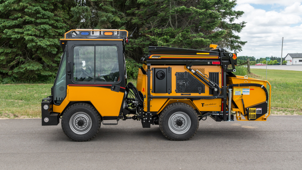 trackless vehicles dump body attachment on sidewalk tractor side view