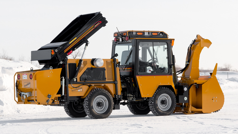 trackless vehicles dump body attachment on sidewalk tractor in snow