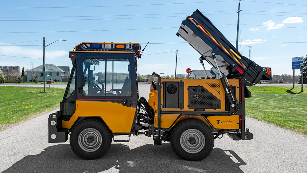 trackless vehicles dump body on sidewalk tractor side view
