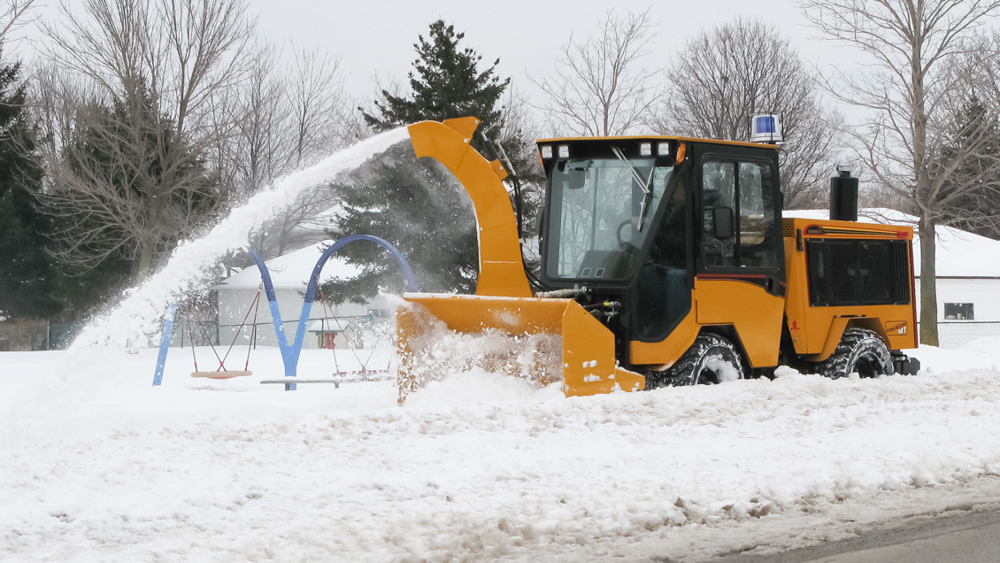 trackless vehicles twin auger snowblower on sidewalk tractor in snow with sidewalk chute
